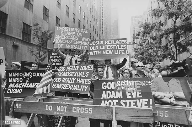 Antigay protestors carry placards opposite St Patrick's Cathedral New York City circa 1980