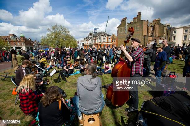Antigentrification protest Reclaim Brixton in central Brixton on 25th April 2015 in the London borough of Lambeth United Kingdom Protesters march...