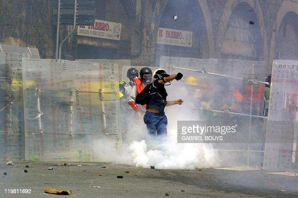 Antiglobalisation activists clash with security forces during a rally against the Group of Eight summit in Genoa 20 July 2001 Leaders from the...