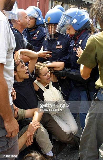 Antiglobalisation militants are pushed back by security forces during protests against the Group of Eight summit in Genoa 20 July 2001 Leaders from...