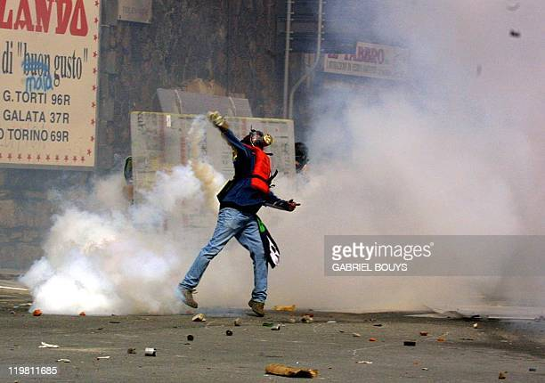 Antiglobalisation militants clash with security forces during a rally against the Group of Eight summit in Genoa 20 July 2001 Leaders from the...