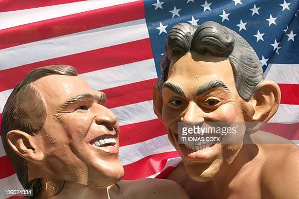 Antiglobalisation protestors in Geneva wear fiberglass effigies of US President George W Bush and British Premeir Tony Blair during a protest 31 May...