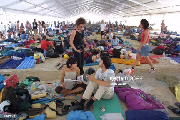 Antiglobalization activists camp out before demonstrations begin against the Group of Eight summit leaders July 19 2001 at Carlini stadium in Genoa...