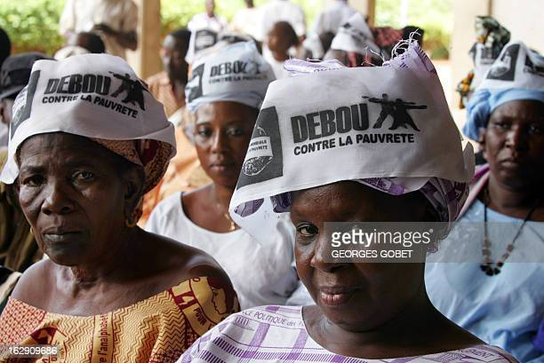 Antiglobalization campaigners wearing scarves bearing the slogan 'Up Against Poverty' attend a debate 06 June 2007 in Sikasso a Malian town 370 kms...