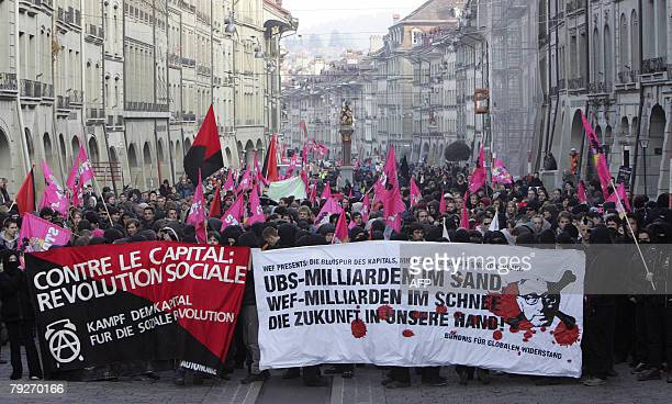 Antiglobalization demonstrators hold banners 26 January 2008 during a demonstration in the old town Bern against the annual meeting of the World...