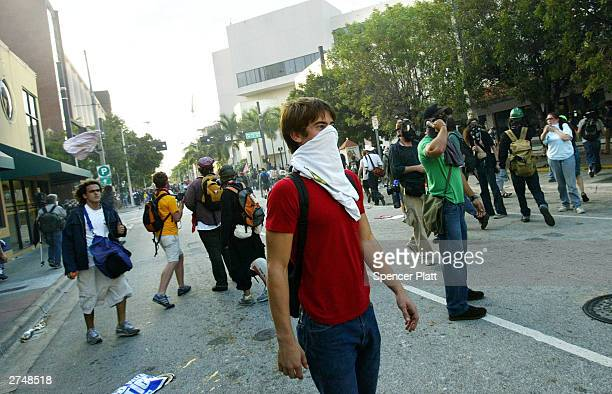 Antiglobalization protesters clash with police on the fourth day of the summit to create a Free Trade Area of the Americas November 20 2003 in Miami...