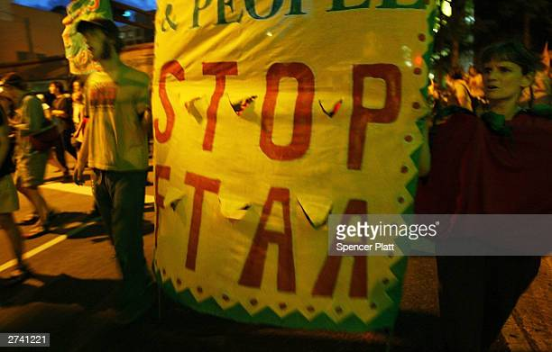 Antiglobalization protesters demonstrate on the second day of the summit to create a Free Trade Area of the Americas November 18 2003 in downtown...