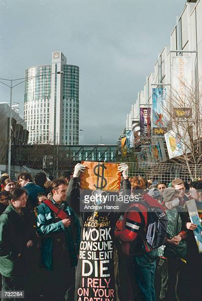 Antiglobalization protesters perform street theatre September 12 2000 outside the World Economic Forum in Melbourne Australia