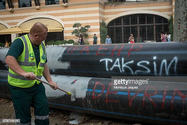 AntiGoverment graffiti is painted over by a municipal worker After a night of violent protests Gezi Park and the Istanbul Municipal services clean up...