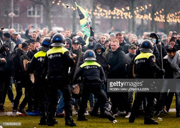 Anti-government activist face off with Dutch police during a protest to denounce ongoing restrictions related to the coronavirus disease pandemic in...
