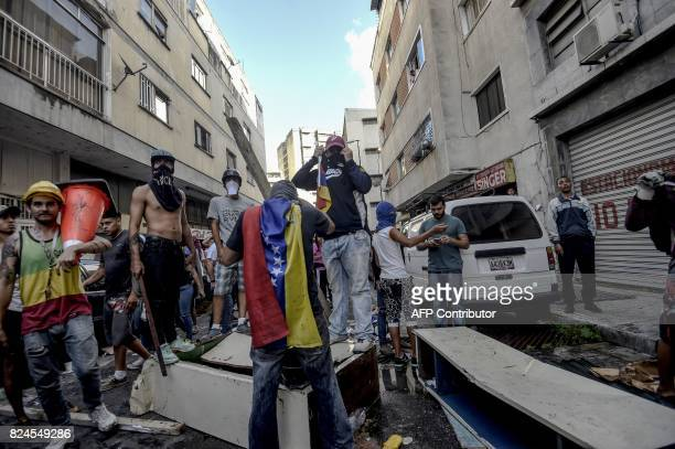 Antigovernment activists attack and set on fire a National Traffic Police station during a protest against the election of a Constituent Assembly...