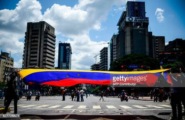 Antigovernment activists demonstrate against Venezuelan President Nicolas Maduro at a barricade set up on a road in Caracas on August 8 2017 Recent...