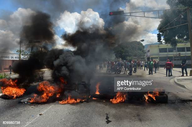 Antigovernment activists set a barricade on fire in Venezuela's third city Valencia on August 6 a day after a new assembly with supreme powers and...