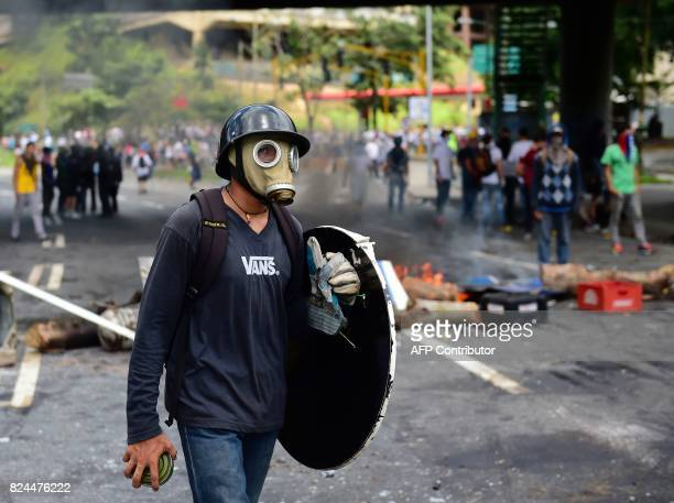 TOPSHOT Antigovernment activists set up barricades during a protest against the elections for a Constituent Assembly in Caracas on July 30 2017...
