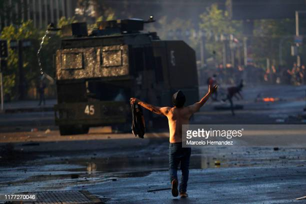 Anti-government demonstrator clashes with police during a protest against cost of living increases on October 20, 2019 in Santiago, Chile. President...