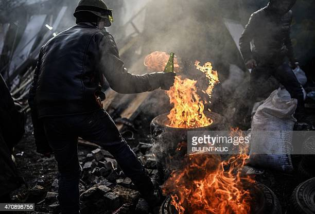 Antigovernment demonstrators build a barricade with burning tires on February 21 2014 at the Independent square in Kiev Armed protesters stormed...