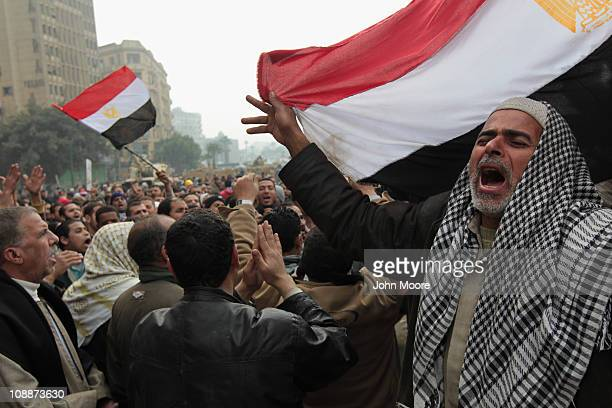 Antigovernment demonstrators chant for freedom in Tahrir Square on February 7 2011 in Cairo Egypt Almost two weeks since the uprising began thousands...