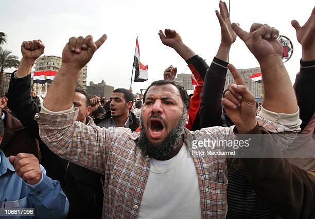 Antigovernment demonstrators chant in Tahrir Square on February 4 2011 in Cairo Egypt Antigovernment protesters have called today 'The day of...