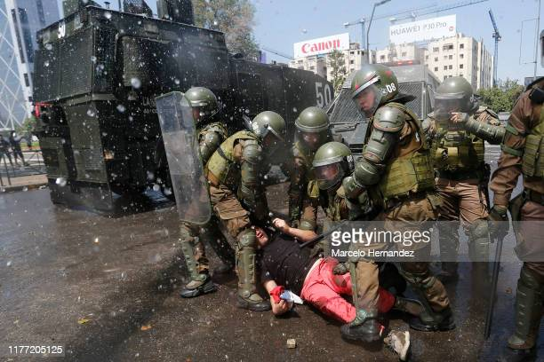 Anti-government demonstrators clash with police as they protest against cost of living increases on October 20, 2019 in Santiago, Chile. President...