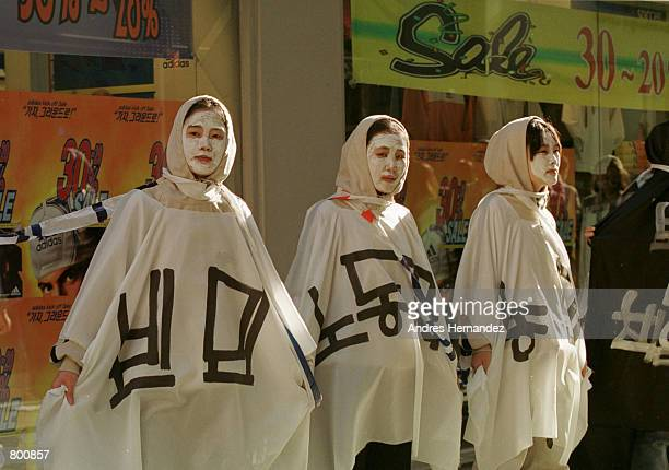 Antigovernment demonstrators dressed as ghosts hold a rally in the shopping district of Seoul South Korea April 6 2000 The protesters opposed...