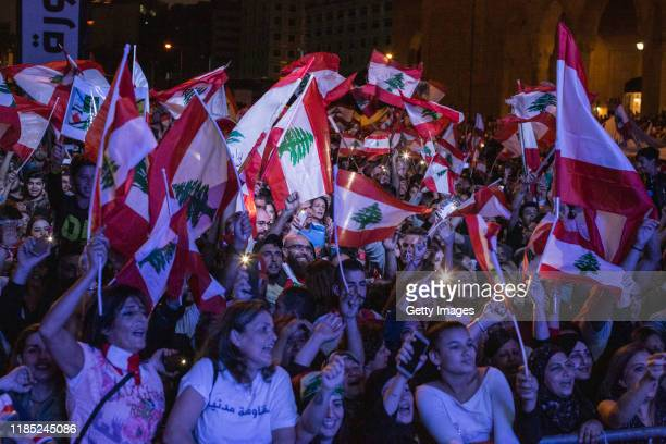 Antigovernment demonstrators gather in Martyrs' Square to listen to speeches and music on November 3 2019 in Beirut Lebanon Lebanon has seen 18 days...