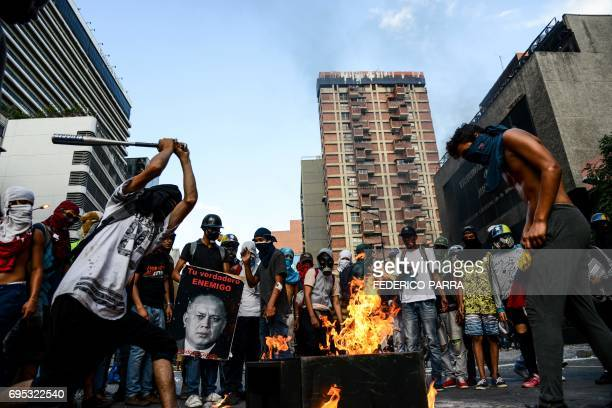 Antigovernment demonstrators loot and later destroy the property of a branch of the Banco Provincial bank which works inside the administration...