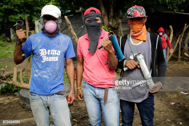Antigovernment demonstrators pose holding handmade mortars in Masaya Nicaragua on June 8 2018 Demand for the makeshift shells has jumped in recent...