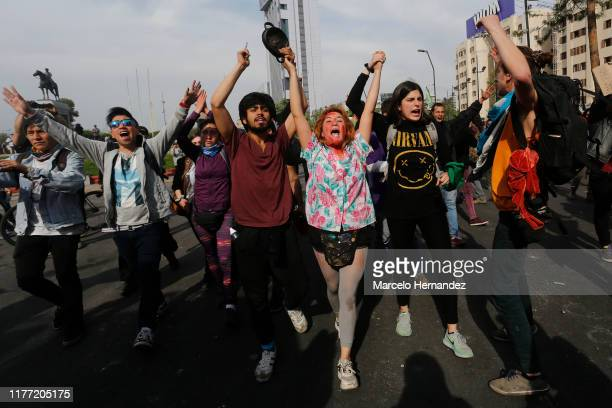 Antigovernment demonstrators protest against cost of living increases on October 20 2019 in Santiago Chile President Sebastian Piñera suspended the...