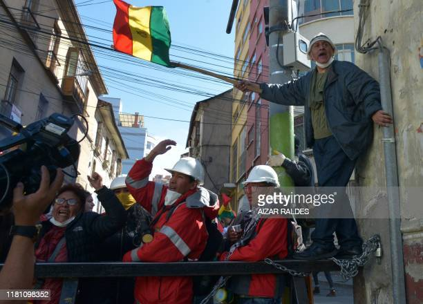 Anti-government demonstrators show their support to members of the Police Special Operations Tactical Unit who joined a rebellion launched on the eve...
