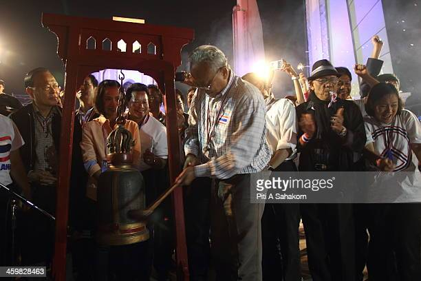 Antigovernment protest leader Suthep Thaugsuban rings a bell during a New Year's Eve celebration at the Democracy Monument in Bangkok Gunmen killed a...