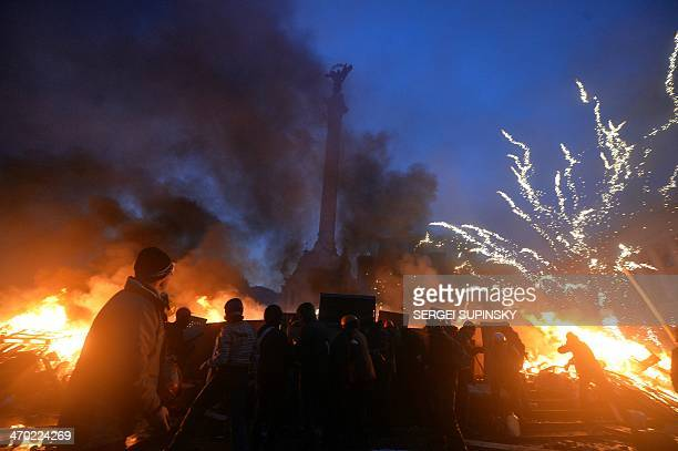 Antigovernment protester clash with the police on Independence Square in Kiev early on February 19 2014 Protesters braced on February 19 for a fresh...