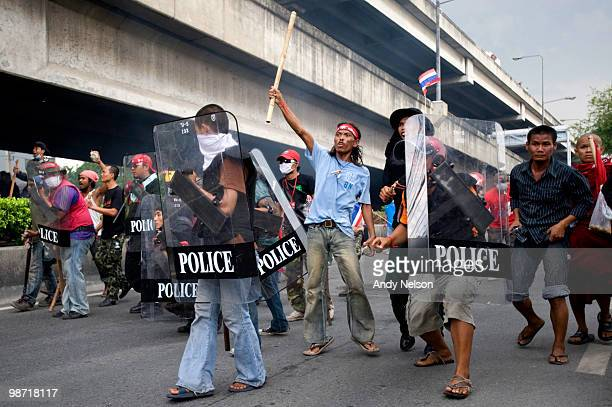 Antigovernment protesters advance on police and military positions during clashes on April 28 2010 in Bangkok Thailand Troops clashed with protesters...
