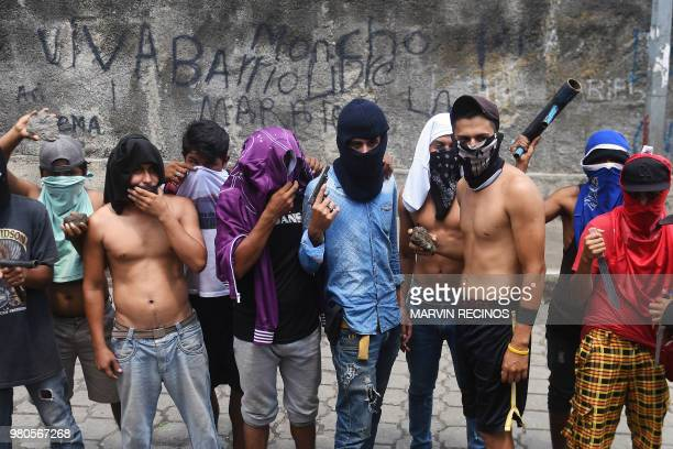 Antigovernment protesters are pictured during clashes with riot police and members of the Sandinista youth in Masaya Nicaragua on June 21 2018...