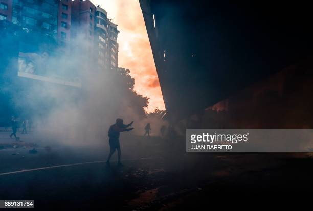 TOPSHOT Antigovernment protesters block the Francisco Fajardo highway in Caracas during a demonstration against Venezuelan President Nicolas Maduro...