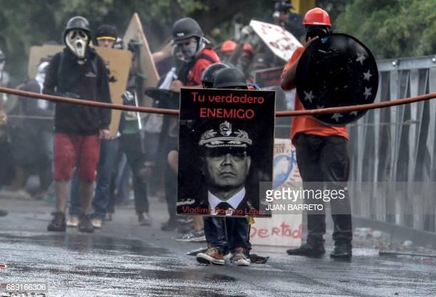 TOPSHOT Antigovernment protesters block the Francisco Fajardo highway in Caracas during a demonstration against Venezuelan President Nicolas Maduro...