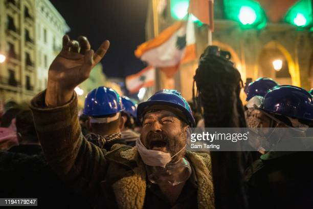 Antigovernment protesters chant at riot police who would later use tear gas and water cannon to disperse demonstrators as they clashed for the second...