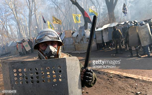 Antigovernment protesters clash with police in front of the Ukrainian Parliament in Kiev on February 18 2014 Police on Tuesday fired rubber bullets...