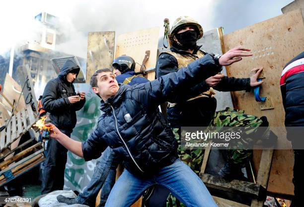 Antigovernment protesters clash with police in Independence Square on February 19 2014 in Kiev Ukraine Violent clashes erupted yesterday following...