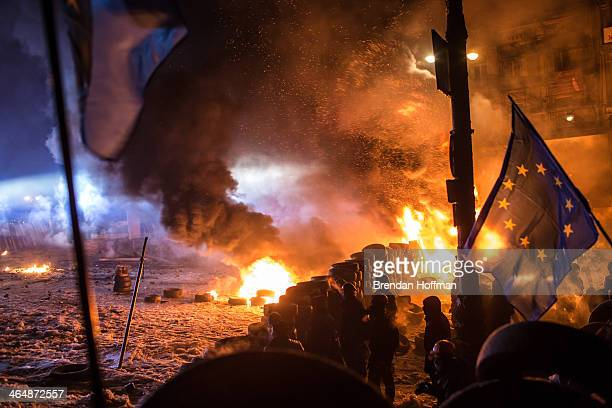 Antigovernment protesters clash with police on Hrushevskoho Street near Dynamo stadium on January 24 2014 in Kiev Ukraine After two months of...