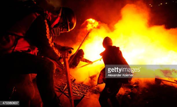 Antigovernment protesters clash with police on Independence Square in Kiev on February 19 2014 in Kiev Ukraine At least 26 people have been killed...