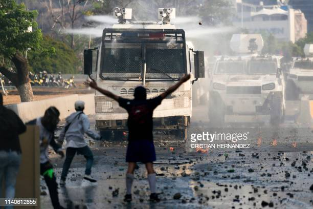 Anti-government protesters clash with security forces in Caracas during the commemoration of May Day on May 1, 2019. - Opposition supporters...