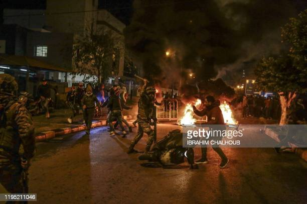 Anti-government protesters clash with the Lebanese army in the coastal city of Tripoli north of Beirut on January 21 as they protest the...