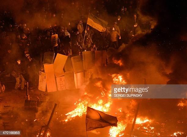 Antigovernment protesters clash with the police during their storm of the Independence Square in Kiev on February 18 2014 Flames engulfed the main...