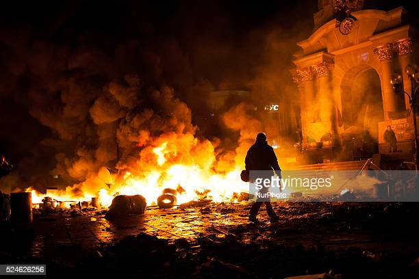 Anti-government protesters clash with the police during their storm of the Independence Square in Kiev on February 18, 2014. Flames engulfed the main...