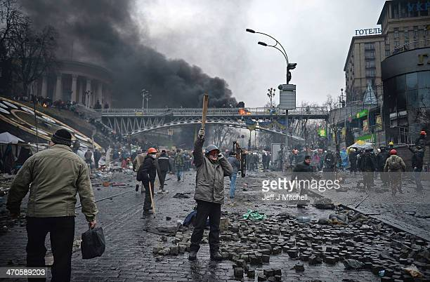 Antigovernment protesters continue to clash with police in Independence square despite a truce agreed between the Ukrainian president and opposition...