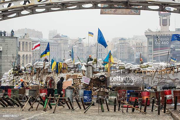 Antigovernment protesters continue to fortify their barricades intended to block the police from forcing them out of Independence Square on December...