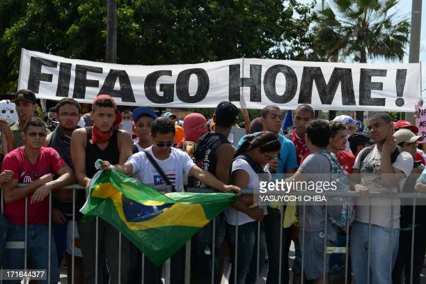 Antigovernment protesters demonstrate at the security perimeter two kilometers from the Castelao stadium in Fortaleza where Spain and Italy are to...