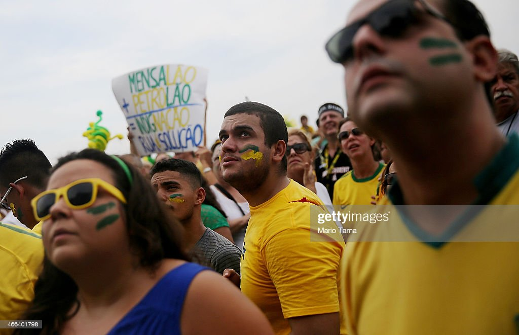 Anti-government protesters gather and march along Copacabana beach on March 15, 2015 in Rio de Janeiro, Brazil. Protests across the country were held today against President Dilma Rousseff's government with many protesters calling for her impeachment. A massive corruption scandal at Brazil's state-owned oil company Petrobras has rocked the government and Dilma's approval ratings are now around 23 percent. Brazil's inflation rate has hovered around ten-year highs recently while the currency, the Brazilian real, has passed twelve-year lows when measured against the U.S. dollar.