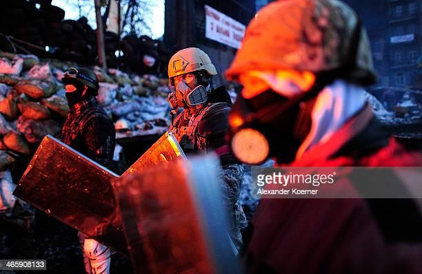 Antigovernment Protesters gather around a fire at a barricade on Grushevskoho Street on January 30 2014 in Kiev Ukraine Ukraine's Prime Minister...