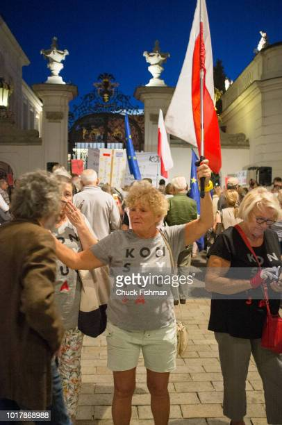 Anti-government protesters gather in front of the presidential palace to rally against a string of judicial reforms that the European Union has...